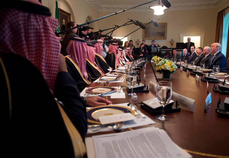 US President Donald Trump (center R) holds a lunch meeting with Saudi Arabia's Crown Prince Mohammed bin Salman (center L), and members of his delegation, in the Cabinet Room of the White House in Washington, DC, March 20, 2018. / AFP PHOTO / SAUL LOEB