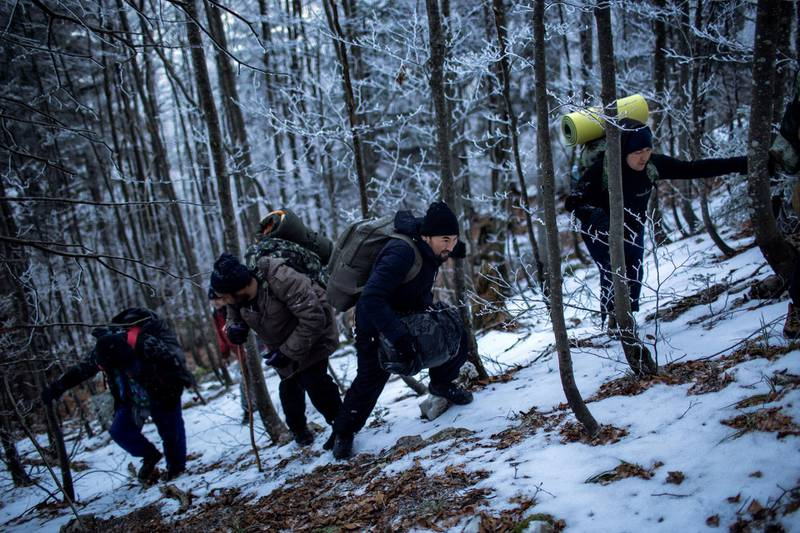 Hossein climbs the mountain together with Rahim and the rest of Afghan migrants during their journey through the forest towards the border with Croatia.