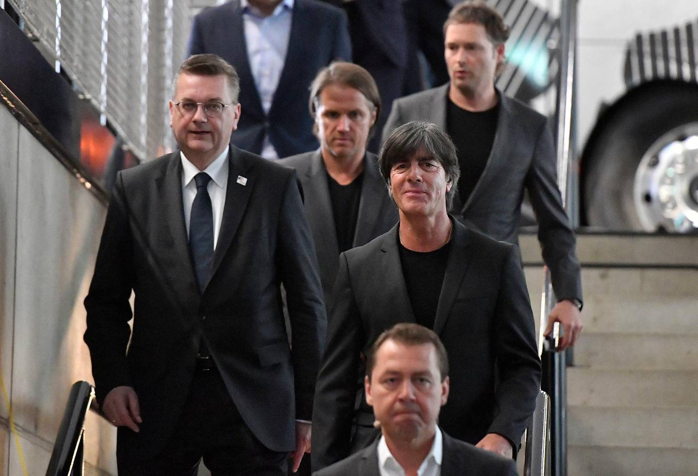 FILE - In this May 15, 2018 file photo DFB (German Football Association) President Reinhard Grindel, left, and head coach Joachim Loew, right, arrive at the German Football Museum in Dortmund, Germany, for the presentation of Germany's team for the Soccer World Cup in Russia. (AP Photo/Martin Meissner, file)