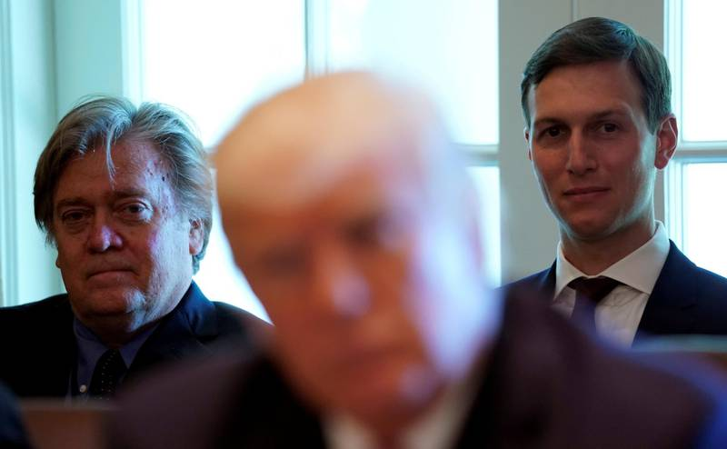 FILE PHOTO:    Trump advisers Steve Bannon (L) and Jared Kushner (R) listen as U.S. President Donald Trump meets with members of his Cabinet at the White House in Washington, U.S., June 12, 2017.  REUTERS/Kevin Lamarque/File Photo