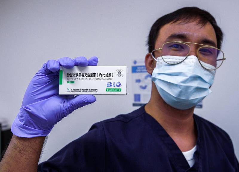 Abu Dhabi, United Arab Emirates, January 12, 2021. SEHA Vaccination Centre at the Abu Dhabi Cruise Terminal area.  Abdulaziz Karmastaji gets vaccinated.Victor Besa/The NationalSection:  NAReporter:  Shireena Al Nowais