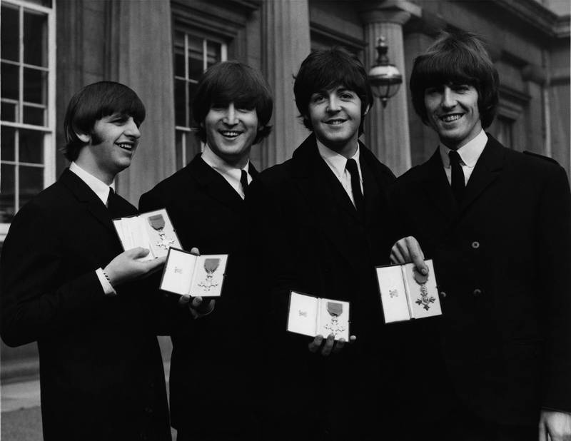 British rock group the Beatles after each received an MBE at Buckingham Palace in London, 26th October 1965. From left to right, Ringo Starr, John Lennon, Paul McCartney, George Harrison. (Photo by William Vanderson/Fox Photos/Hulton Archive/Getty Images)