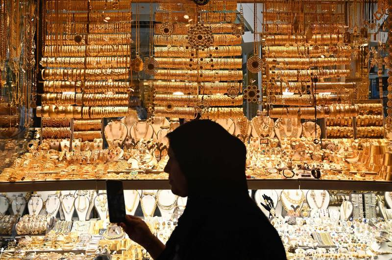 A woman walks past a gold shop on July 13, 2019 at the historical spice bazaar at Eminonu district in Istanbul.  / AFP / Ozan KOSE