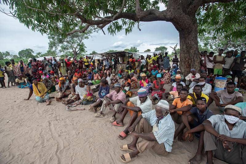 Internally displaced persons gather for a community meeting in the Tara Tara district of Matuge, northern Mozambique, February 24, 2021. - The place functions as a center for internally displaced persons (IDPs) who fled their communities due to attacks by armed insurgents in the northern part of the Cabo Delgado province. Currently, there are 500 families, according to government figures. (Photo by Alfredo Zuniga / AFP)