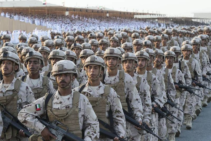 ZAYED MILITARY CITY, ABU DHABI, UNITED ARAB EMIRATES - November 28, 2017: Recruits participate in a parade during the graduation ceremony of the 8th cohort of National Service recruits and the 6th cohort of National Service volunteers at Zayed Military City.   ( Christopher Pike for the Crown Prince Court - Abu Dhabi ) ---