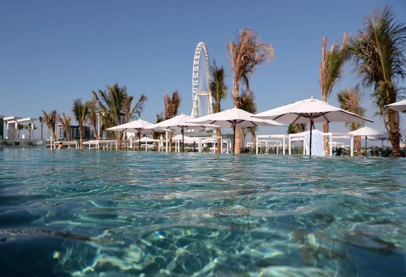 DUBAI, UNITED ARAB EMIRATES , December 24 – 2020 :- Pool area at the Address Beach Resort near Jumeirah Beach Residences in Dubai. ( Pawan Singh / The National ) For Lifestyle. Story by Janice