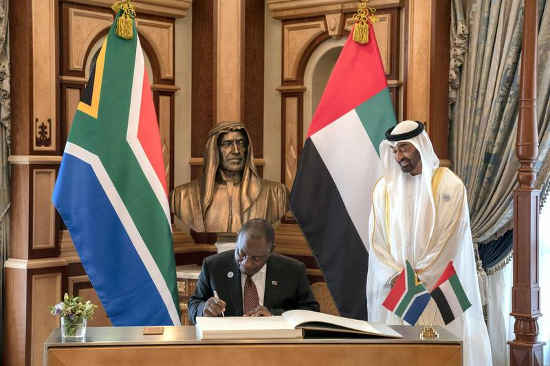 HECyril Ramaphosa, President of South Africa (L) signs a guest book during a reception at the Presidential Palace. Seen with HH Sheikh Mohamed bin Zayed Al Nahyan, Crown Prince of Abu Dhabi and Deputy Supreme Commander of the UAE Armed Forces (R).  ( Hamad Al Kaabi / Crown Prince Court - Abu Dhabi )