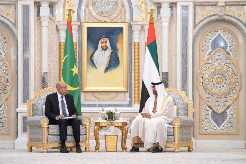 ABU DHABI, UNITED ARAB EMIRATES - February 02, 2020: HH Sheikh Mohamed bin Zayed Al Nahyan, Crown Prince of Abu Dhabi and Deputy Supreme Commander of the UAE Armed Forces (R), meets with HE Mohamed Ould Ghazouani, President of Mauritania (L), during an official visit at Qasr Al Watan.   ( Hamad Al Kaabi  / Ministry of Presidential Affairs ) ---