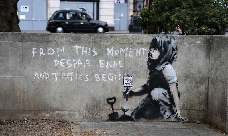 epa07529993 A wall art reported to be a new Banksy artwork in Marble Arch in London, Britain, 26 April 2019. The new wall art is at the site of the Extinction Rebellion camp at Marble Arch where climate change demonstrators protested for more than a week in London.  EPA-EFE/ANDY RAIN