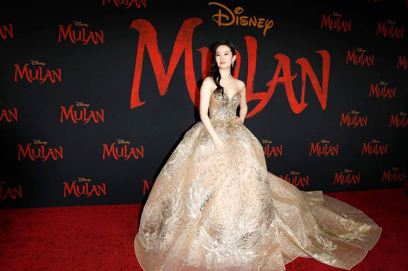 epa08282387 Chinese-American actress Liu Yifei wears an Elie Saab gown as she arrives for the world premiere of the movie 'Mulan' at the Dolby Theatre in Hollywood, Los Angeles, California, USA, 09 March 2020. The movie opens in theatres in the USA on 27 March 2020.  EPA-EFE/NINA PROMMER