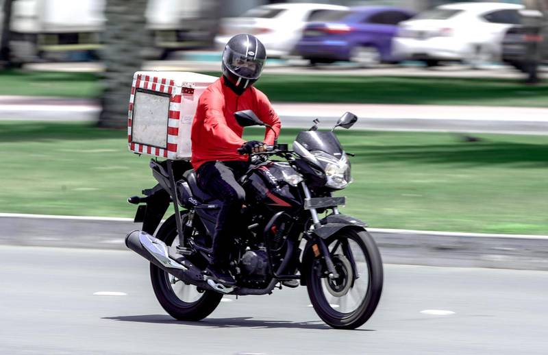 Abu Dhabi, United Arab Emirates, April 24, 2020.    A delivery man at downtown Abu Dhabi during the first morning of Ramadan.Section:  NAFor:  Standalone/Stock Images