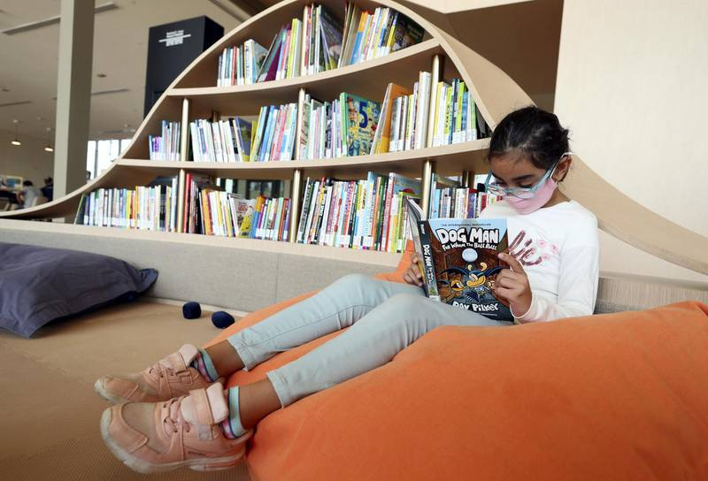 Sharjah, United Arab Emirates - December 10, 2020: News. Arts. Dima aged 7 reads in the childrens area. Opening of the House of Wisdom, a high tech new library. Thursday, December 10th, 2020 in Sharjah. Chris Whiteoak / The National
