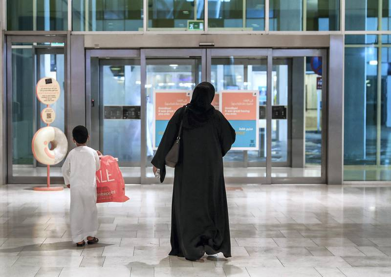 """Abu Dhabi, United Arab Emirates, August 19, 2020.  Yas Mall keeping up with DCT's Covid-19 precautionary measures """"Go Safe"""", for instance, they have a robot taking the temperature of customers, an automatic elevator sanitising machine.Victor Besa /The NationalSection:  NAReporter:  Haneen Dajani"""