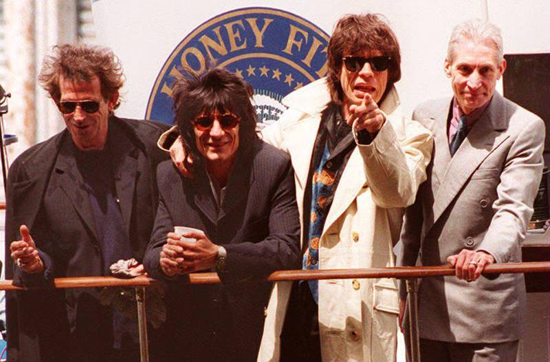 """The Rolling Stones (L-R) Keith Richards, Ron Wood, Mick Jagger and Charlie Watts arrive by yacht at Chelsea Piers 03 May 1994 in New York to kick-off their """"Voodoo Lounge """" world tour 01 August. It is also the first time the Stones have toured without their bass player Bill Wyman, who left the group last year. (Photo by TIMOTHY A. CLARY / AFP)"""