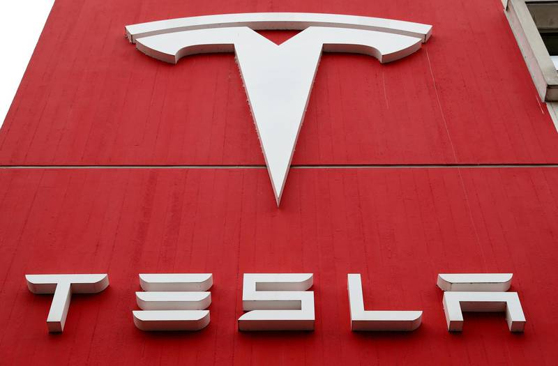 FILE PHOTO: FILE PHOTO: The logo of car manufacturer Tesla is seen at a branch office in Bern, Switzerland October 28, 2020. REUTERS/Arnd Wiegmann/File Photo/File Photo