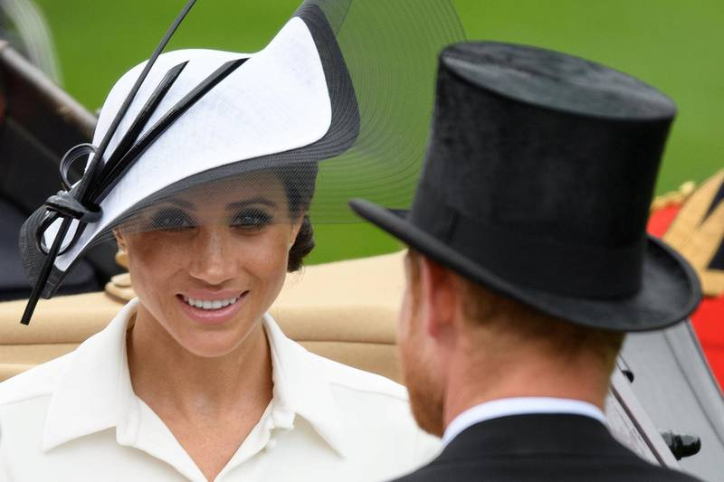 ASCOT, ENGLAND - JUNE 19:   Meghan, Duchess of Sussex (L) and Prince Harry, Duke of Sussex attend day one of Royal Ascot at Ascot Racecourse on June 19, 2018 in Ascot, United Kingdom. Royal Ascot is Britain's most valuable race meeting, attracting many of the world's finest racehorses to compete for more than £7.3m in prize money.  (Photo by Leon Neal/Getty Images)