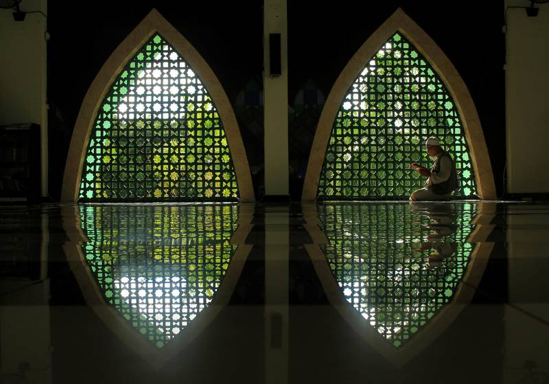 Indonesian Muslim man reads the Koran inside a mosque during the holy fasting month of Ramadan, amid the spread of coronavirus disease (COVID-19) outbreak in Mamuju, West Sulawesi province, Indonesia, April 24, 2020 in this photo taken by Antara Foto.  Antara Foto/Akbar Tado/via REUTERS    ATTENTION EDITORS - THIS IMAGE WAS PROVIDED BY A THIRD PARTY. MANDATORY CREDIT. INDONESIA OUT.