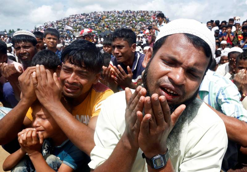 FILE PHOTO: Rohingya refugees pray at a gathering mark the second anniversary of their exodus from Myanmar, at the Kutupalong camp in Cox's Bazar, Bangladesh, August 25, 2019. REUTERS/Rafiqur Rahman/File Photo