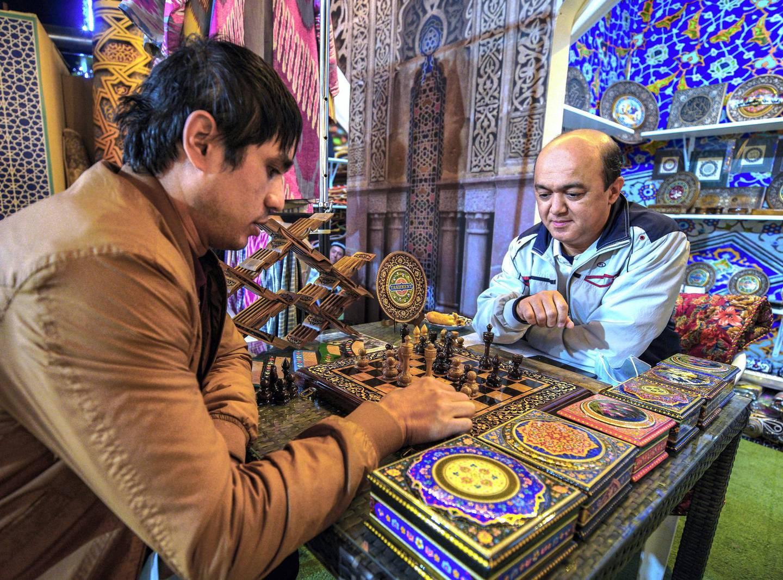 Abu Dhabi, United Arab Emirates, January 10, 2021. Kamaliddin Abdullaev plays chess on a wooden hand made chess board from Uzbekistan at  the Sheikh Zayed Festival.Victor Besa/The NationalSection:  NAReporter:  Saeed Saeed