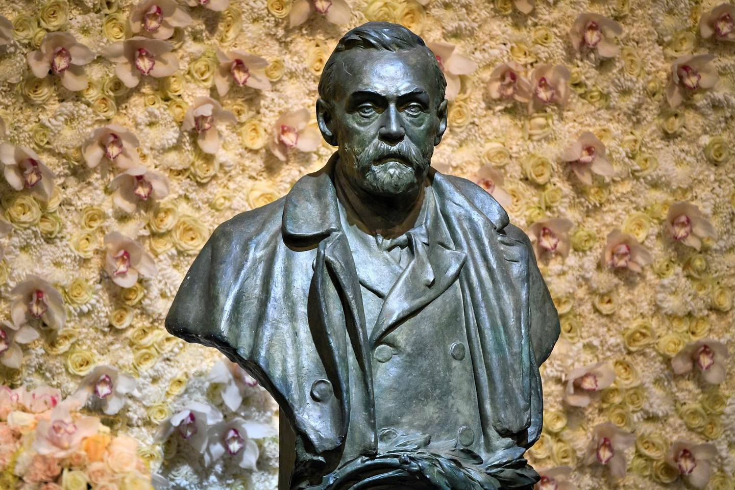 FILE PHOTO: A bronze bust of Alfred Nobel is pictured before the Nobel Prize ceremony at Stockholm Concert Hall, in Stockholm, Sweden December 10, 2019. TT News Agency/Claudio Bresciani via REUTERS   ATTENTION EDITORS - THIS IMAGE WAS PROVIDED BY A THIRD PARTY. SWEDEN OUT. NO COMMERCIAL OR EDITORIAL SALES IN SWEDEN./File Photo