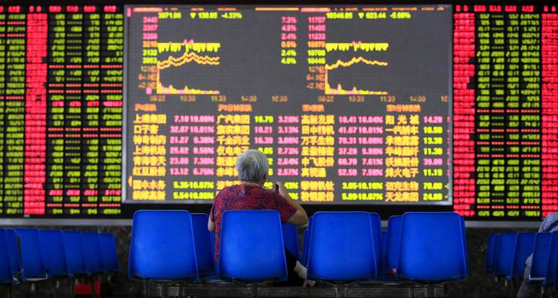 An investor looks at an electronic board showing stock information at a brokerage house in Shanghai, August 25, 2015. China's major stock indexes sank more than 6 percent in early trade on Tuesday, after a catastrophic Monday that saw Chinese exchanges suffer their biggest losses since the global financial crisis, destabilizing financial markets around the world. REUTERS/Aly Song      TPX IMAGES OF THE DAY