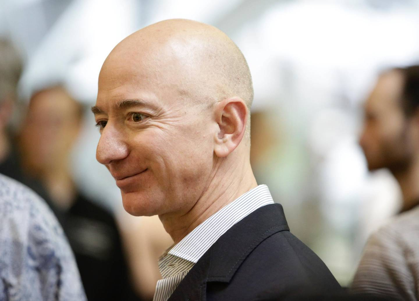 (FILES) In this file photo taken on January 29, 2018 Chief Executive Officer of Amazon, Jeff Bezos, tours the facility at the grand opening of the Amazon Spheres, in Seattle, Washington. Jeff Bezos is officially the richest person on the planet thanks to the success of Amazon -- but his bold vision extends to space and even time itself.With Amazon's share price up nearly 60 percent during the past year, the personal wealth of the company's 54-year-old founder has doubled to more than $110 billion.  / AFP PHOTO / JASON REDMOND