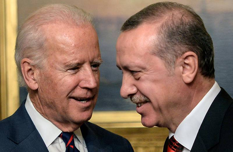 (FILES) In this file photo taken on November 22, 2014, US Vice President Joe Biden (L) speaks with Turkish President Recep Tayyip Erdogan at Beylerbeyi Palace in Istanbul.  President Biden has opened his presidency by taking a visibly harder line on Turkey, with analysts expecting a rocky path ahead between the uneasy allies as their interests increasingly diverge. Erdogan, like many of the leaders who wooed Biden's predecessor Donald Trump, is getting an early cold shoulder from Biden, who before being elected described the Islamist-aligned populist an autocrat and promised to empower the opposition. / AFP / Bulent KILIC