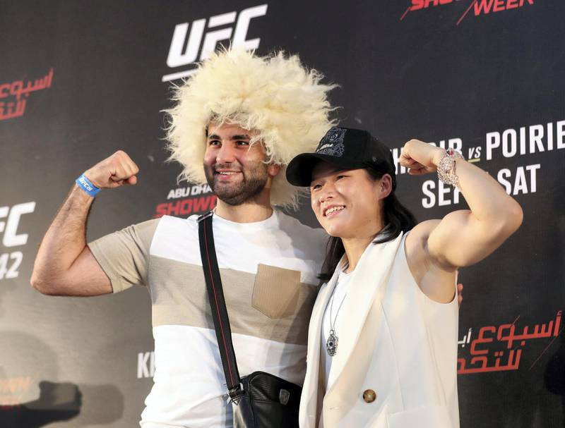 Abu Dhabi, United Arab Emirates - September 06, 2019: Fight fans with fighter Wei Lee at the UFC fan zone. Friday the 6th of September 2019. Yes Island, Abu Dhabi. Chris Whiteoak / The National