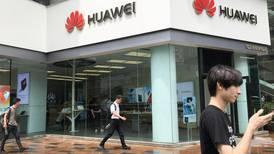 US holds off on Huawei licenses as China stops buying farming goods