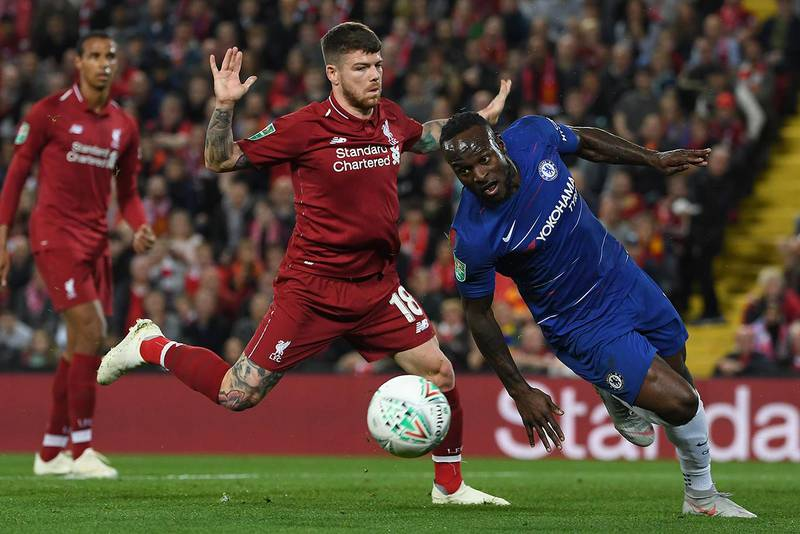 Liverpool's Spanish defender Alberto Moreno (L) vies with Chelsea's Nigerian midfielder Victor Mosesduring the English League Cup third round football match between Liverpool and Chelsea at Anfield in Liverpool, north west England on September 26, 2018. (Photo by Paul ELLIS / AFP) / RESTRICTED TO EDITORIAL USE. No use with unauthorized audio, video, data, fixture lists, club/league logos or 'live' services. Online in-match use limited to 120 images. An additional 40 images may be used in extra time. No video emulation. Social media in-match use limited to 120 images. An additional 40 images may be used in extra time. No use in betting publications, games or single club/league/player publications. /