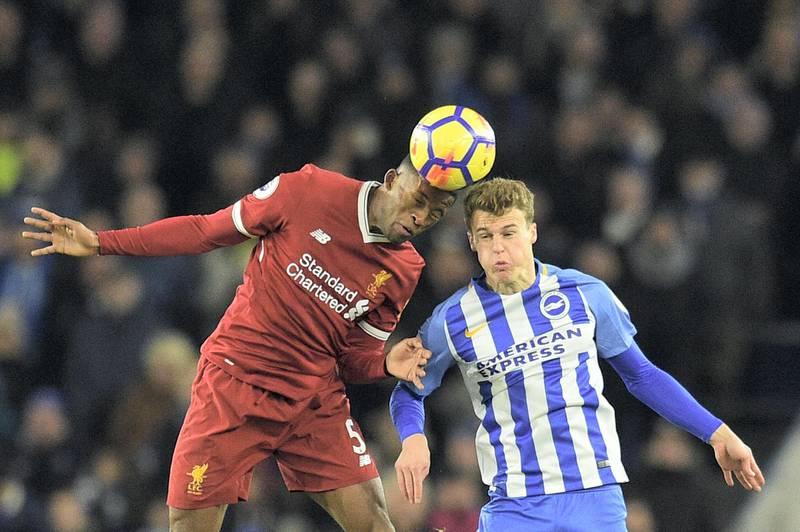 Liverpool's Dutch midfielder Georginio Wijnaldum (L) beats Brighton's English midfielder Solly March (R) in the air during the English Premier League football match between Brighton and Hove Albion and Liverpool at the American Express Community Stadium in Brighton, southern England on December 2, 2017. / AFP PHOTO / Glyn KIRK / RESTRICTED TO EDITORIAL USE. No use with unauthorized audio, video, data, fixture lists, club/league logos or 'live' services. Online in-match use limited to 75 images, no video emulation. No use in betting, games or single club/league/player publications.  /