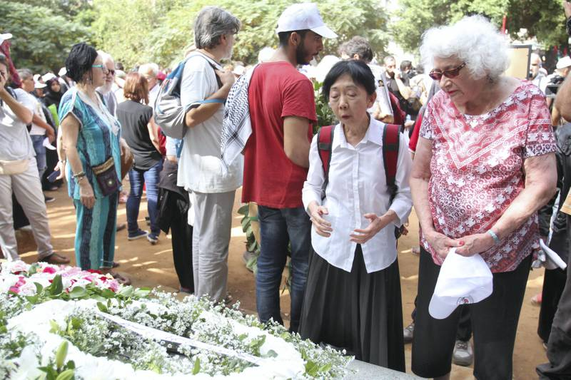 Ellen Siegel and Ang Swee visit a memorial to the more than 1,300 victims of the Sabra and Shatila massacre in 1982. Siegel and Swee both worked at Gaza Hospital in Shatila when the massacre took place. Siegal is from Washington, DC and Swee is from London.