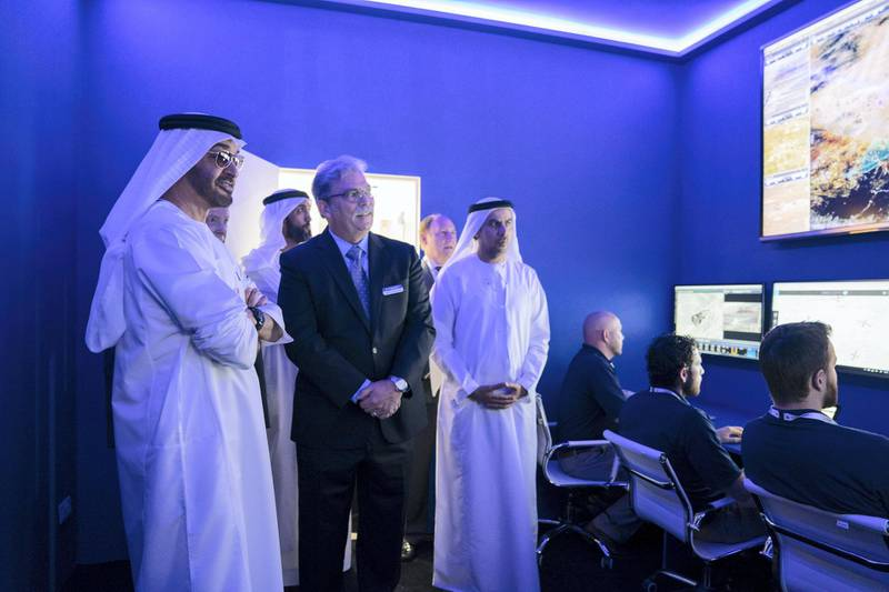 ABU DHABI, UNITED ARAB EMIRATES - February 18, 2019: HH Sheikh Mohamed bin Zayed Al Nahyan, Crown Prince of Abu Dhabi and Deputy Supreme Commander of the UAE Armed Forces (L) tours the 2019 International Defence Exhibition and Conference (IDEX), at Abu Dhabi National Exhibition Centre (ADNEC).  ( Mohamed Al Hammadi / Ministry of Presidential Affairs ) ---