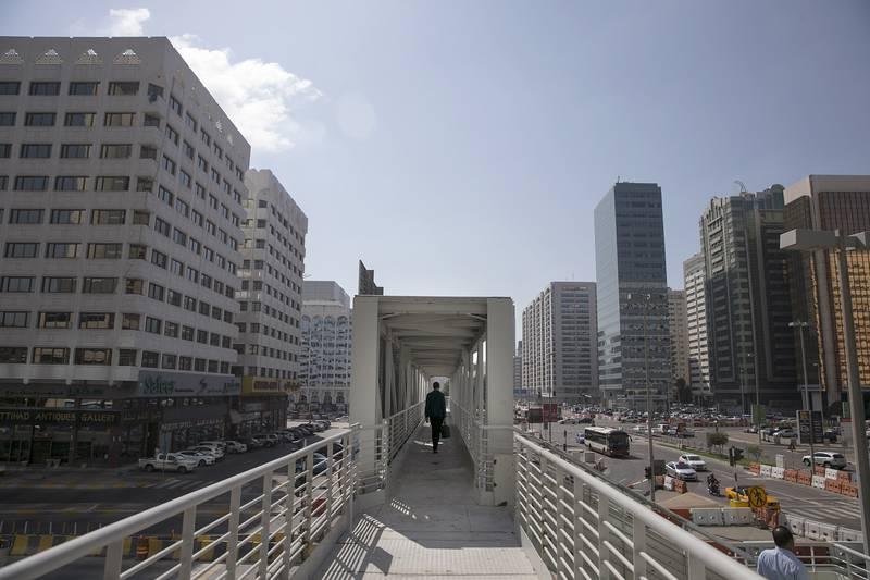 ABU DHABI, UNITED ARAB EMIRATES, Feb. 9, 2014:    A man walks in the overpass near the Abu Dhabi Mall, in the newly-renamed neighborhood, the Al Zahiya, formerly the Tourist Club, on Feb. 10, 2014, in Abu Dhabi.  (Silvia Razgova / The National)  Reporter: Anwar Hajikaram Section: National Usage: Feb. 11, 2014