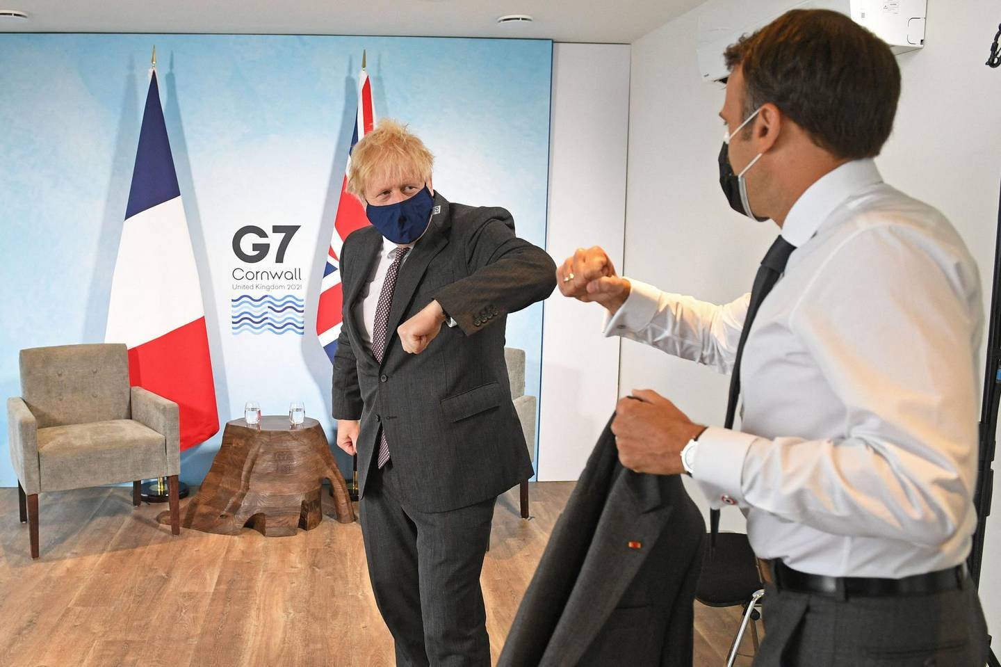 Britain's Prime Minister Boris Johnson greets France's President Emmanuel Macron before a bilateral meeting during the G7 summit in Carbis bay, Cornwall on June 12, 2021. / AFP / POOL / Stefan Rousseau