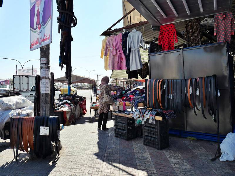 Pictured: A lady browses the clothes of a shop in Zarqa, a city lcoated 30km north east of Amman, where a 16-year-old boy was abducted, raped and tortured in a revenge attack.  19/10/2020 Photographer: Charlie Faulkner