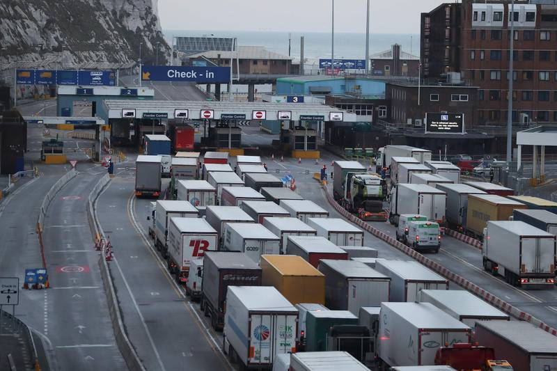 """(FILES) In this file photo taken on March 19, 2018 lorries queue up at the port of Dover on the south coast of England. Government failures to prepare for Brexit mean the UK faces """"significant disruption"""" when it is fully free of the European Union on January 1, an official watchdog said Friday, November 6. / AFP / Daniel LEAL-OLIVAS"""