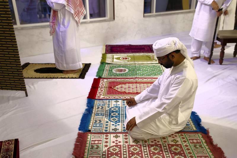 Dubai, United Arab Emirates - May 15, 2019: Prayers are made before Iftar. People take part in a multi faith Iftar at Gurunanak Darbar Sikh Gurudwara. Wednesday the 15th of May 2019. Jebel Ali, Dubai. Chris Whiteoak / The National