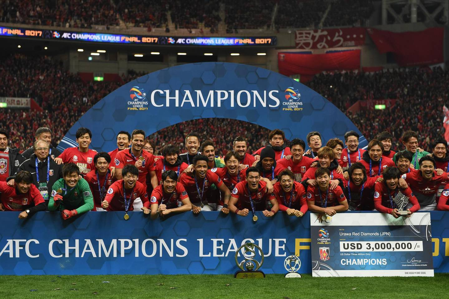 SAITAMA, JAPAN - NOVEMBER 25:  Urawa Red Diamonds players and staffs pose for photographs after the AFC Champions League Final second leg match between Urawa Red Diamonds and Al-Hilal at Saitama Stadium on November 25, 2017 in Saitama, Japan.  (Photo by Etsuo Hara/Getty Images)