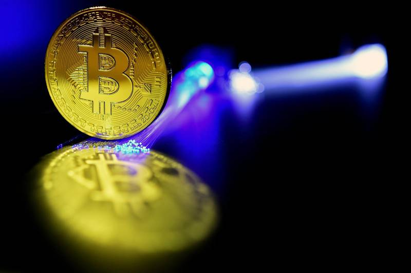 epaselect epa06407072 A Bitcoin is pictured in Duesseldorf, Germany, 27 December 2017. Wild swings in the price of bitcoin took a pause, after it temporarily dropped to 10,800 US dollar. The cryptocurrency's value plummeted by nearly a third last week, and was dealt another potential blow when the Israeli Securities Agency said it would bar companies trading in bitcoin from operating on the Tel Aviv stock exchange and investigate how to regulate the digital currency because of concerns about volatile prices.  EPA/SASCHA STEINBACH