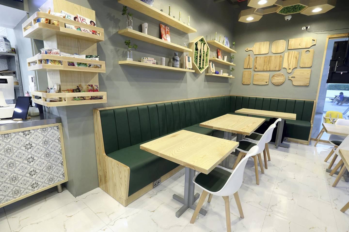 Abu Dhabi, United Arab Emirates - September 15, 2019: A look at the newly opened Sweet Greens café. They have a special focus on being healthy and environmentally friendly. Sunday the 15th of September 2019. Rihan Heights, Abu Dhabi. Chris Whiteoak / The National
