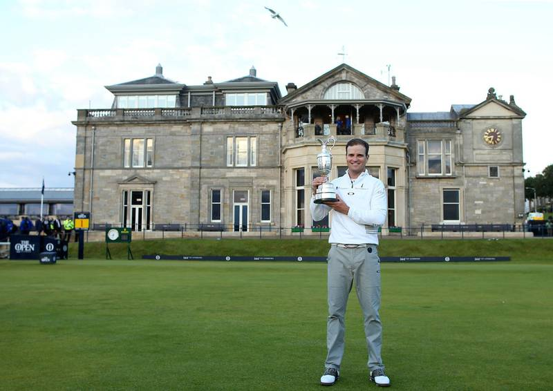 """FILE - A Monday, July 20, 2015 file photo of United States' Zach Johnson posing with the claret jug trophy after winning a playoff after the final round at the British Open Golf Championship at the Old Course, St. Andrews, Scotland. The British Open is returning to the home of golf in 2021. The Old Course will host the 150th anniversary of the world's oldest major to mark """"a true celebration of golf's original championship and its historic ties to St Andrews,"""" the R&A said Monday, Feb. 12, 2018. (AP Photo/Peter Morrison, File)"""