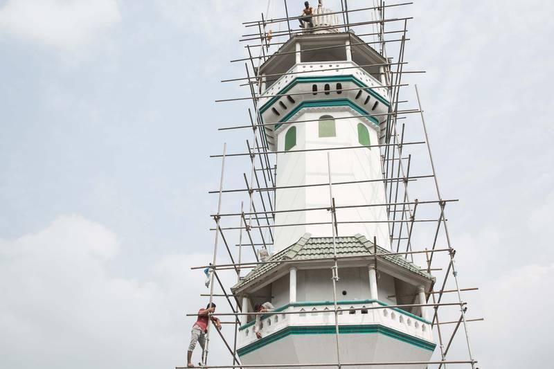 The minaret of Mamburam Grand Juma Masjid is being maintained in Mampuram, Kerala, India. Photo by Sebastian Castelier