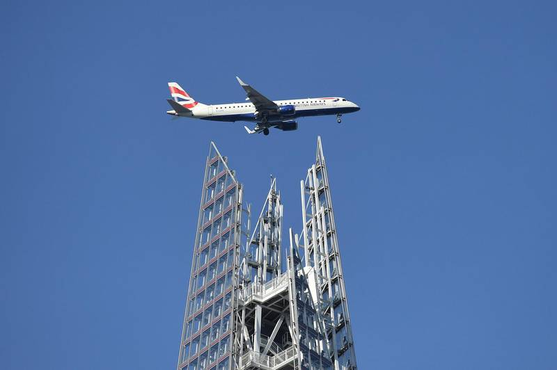 LONDON, ENGLAND - FEBRUARY 14: A British Airways plane makes it way towards City Airport, passing over the Shard building on February 14, 2019 in London, England.  (Photo by Leon Neal/Getty Images)
