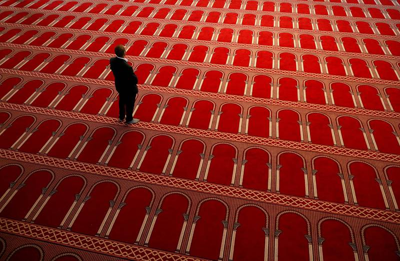 A man is pictured inside the closed Great Mosque of Brussels during the first day of Ramadan amid the coronavirus disease (COVID-19) outbreak, Belgium April 24, 2020. REUTERS/Francois Lenoir     TPX IMAGES OF THE DAY