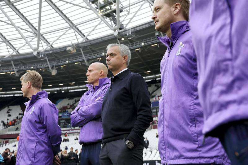 Tottenham Hotspur's Portuguese head coach Jose Mourinho (C) watches the players warm up before the start of the English Premier League football match between West Ham United and Tottenham Hotspur at The London Stadium, in east London on November 23, 2019. (Photo by Adrian DENNIS / AFP) / RESTRICTED TO EDITORIAL USE. No use with unauthorized audio, video, data, fixture lists, club/league logos or 'live' services. Online in-match use limited to 120 images. An additional 40 images may be used in extra time. No video emulation. Social media in-match use limited to 120 images. An additional 40 images may be used in extra time. No use in betting publications, games or single club/league/player publications. /