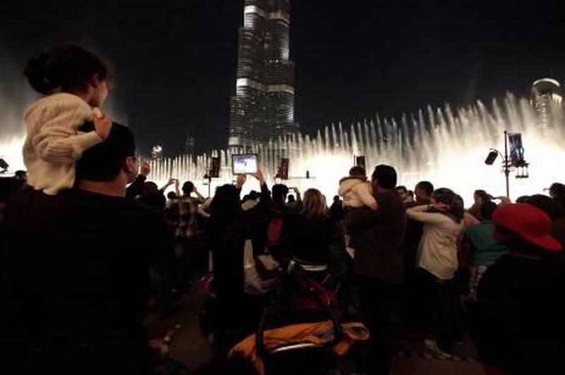 Dubai, United Arab Emirates - December 31, 2012.  Spectators waiting for the New Years fireworks spectacle around Burj Khalifa.  ( Jeffrey E Biteng / The National )
