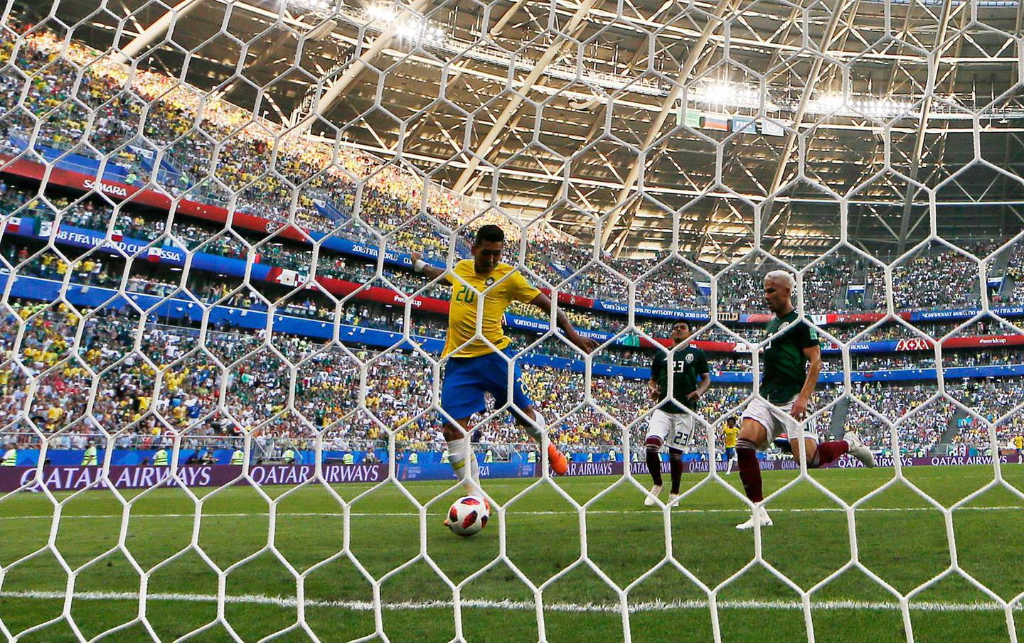 epa06858506 Roberto Firmino (C) of Brazil scores the 2-0 during the FIFA World Cup 2018 round of 16 soccer match between Brazil and Mexico in Samara, Russia, 02 July 2018.  (RESTRICTIONS APPLY: Editorial Use Only, not used in association with any commercial entity - Images must not be used in any form of alert service or push service of any kind including via mobile alert services, downloads to mobile devices or MMS messaging - Images must appear as still images and must not emulate match action video footage - No alteration is made to, and no text or image is superimposed over, any published image which: (a) intentionally obscures or removes a sponsor identification image; or (b) adds or overlays the commercial identification of any third party which is not officially associated with the FIFA World Cup)  EPA/SERGEY DOLZHENKO   EDITORIAL USE ONLY