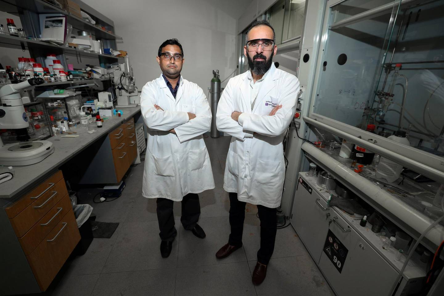 Abu Dhabi, United Arab Emirates - May 22, 2019: An article about research at New York University Abu Dhabi into new ways of delivering anti-cancer drugs into cancer cells. An associate professor at the university, Dr Ali Trabolsi (R), has published a paper showing positive results on cancer cell lines and zebrafish embryos using a type of anti-cancer molecule that his lab has developed. With Prakasam Thirumurugan. Wednesday the 22nd of May 2019. NYU Abu Dhabi, Abu Dhabi. Chris Whiteoak / The National