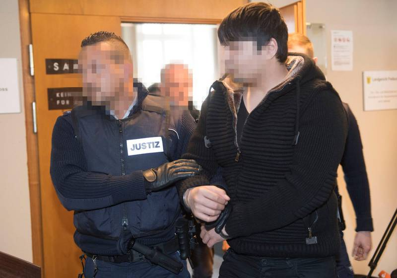 Defendant Hussein K (R) is led out of the court room after beeing sentenced for life imprisonment at the regional court in Freiburg, southern Germany, on March 22, 2018. The asylum seeker claiming to be from Afghanistan was sentenced to life in jail for the rape and murder of a student that stoked public fears and a backlash against a mass influx of migrants. / AFP PHOTO / THOMAS KIENZLE / GERMAN COURT REQUESTS THAT THE FACES OF THE DEFENDANT AND OF JUDICIAL OFFICERS MUST BE MADE UNRECOGNISABLES